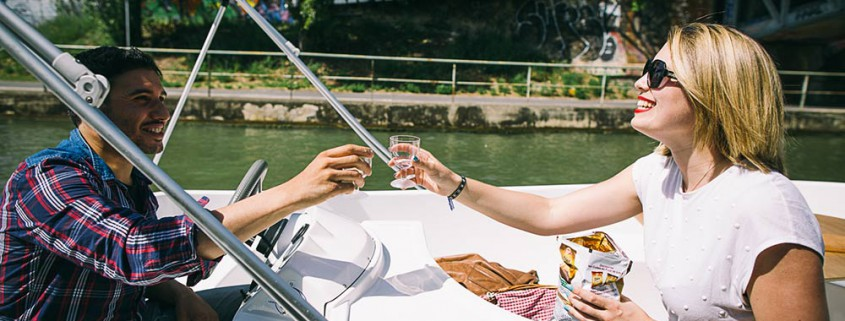 A couple toasting on a boat